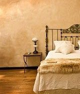 bed with plaster wall
